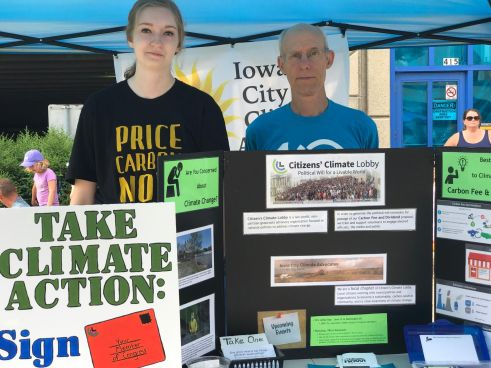 ICCA members Maria McCoy and John Macatee tabling at the Iowa City Farmers' Market 7/22/17