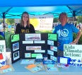 ICCA members Maria McCoy and Sean Turner encourage people to write to their representatives at a tabling event in Cedar Rapids, August 2017